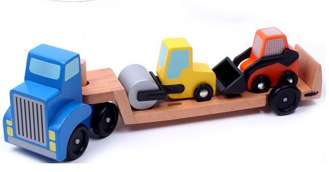 Camion-cu-platforma-din-lemn-cu-vehicule-de-constructii.jpg